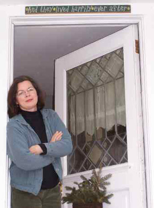 Elvira Woodruff at the door of her home.